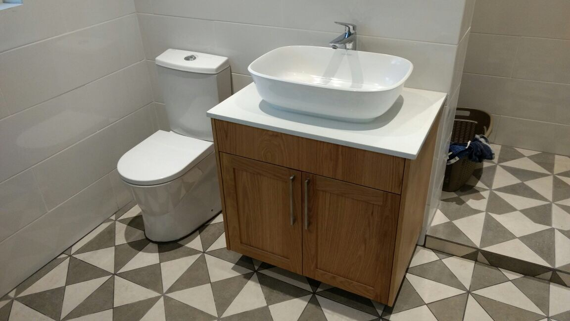 Toilet and Basin with built in cupboard